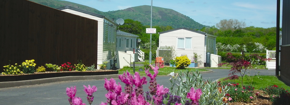 Example Holiday Caravans on Oakmere Holiday Park with Malvern Hills as the Backdrop